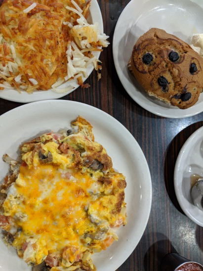 Some omelette, hash browns, and a blueberry muffin from Perry's Cafe.