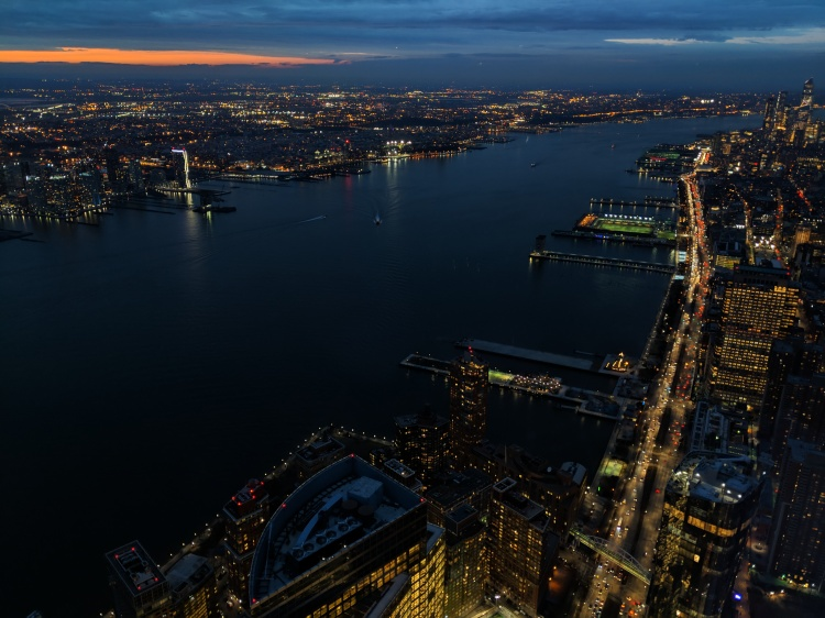 Sunset view of New York City from the One World Trade Center Observatory.